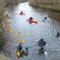 divers and kayakers in irwell